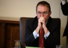 """FILE- In this Jan. 2, 2019, file photo White House chief of staff Mick Mulvaney listens as President Donald Trump speaks during a cabinet meeting at the White House in Washington. Mulvaney says Trump is prepared for another government shutdown if Congress won't work with him to secure the southern border. Mulvaney spoke Sunday, Jan. 27, on CBS' """"Face the Nation"""" and """"Fox News Sunday."""" (AP Photo/Evan Vucci, File)"""