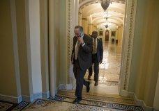 Senate Minority Leader Sen. Chuck Schumer of N.Y. arrives on Capitol Hill in Washington, Thursday, Jan. 24, 2019. (AP Photo/Andrew Harnik)