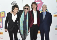 """FILE - In this Nov. 15, 2016 file photo, The Rolling Stones, from left, Ronnie Wood, Keith Richards, Mick Jagger and Charlie Watts attend the opening night party for """"Exhibitionism"""" at Industria in New York. The New Orleans Jazz and Heritage Festival has got satisfaction: The Rolling Stones are among headliners for the 50th anniversary festival. Organizers Tuesday, Jan. 15, 2019, confirmed reports that Mick Jagger and his band will play. (Photo by Evan Agostini/Invision/AP, File)"""