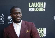 "FILE - In this Aug. 3, 2017 file photo, Kevin Hart poses at Kevin Hart's ""Laugh Out Loud"" new streaming video network launch event at the Goldstein Residence in Beverly Hills, Calif. Prodded by Ellen DeGeneres, Hart says he'll reconsider his decision to step down as host of the Academy Awards. Two days after he was named as host last Dec. 2018, Hart backed off when some of his homophobic tweets from a decade ago resurfaced. (Photo by Danny Moloshok/Invision/AP, File)"
