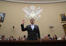 Michael Cohen, President Donald Trump's former personal lawyer, is sworn in to testify before the House Oversight and Reform Committee on Capitol Hill in Washington, Wednesday, Feb. 27, 2019. (AP Photo/J. Scott Applewhite)