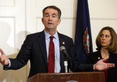 Virginia Gov. Ralph Northam, left, accompanied by his wife, Pam, speaks during a news conference in the Governor's Mansion in Richmond, Va., on Saturday, Feb. 2, 2019. Resisting widespread calls for his resignation, Northam on Saturday vowed to remain in office after disavowing a racist photograph that appeared under his name in his 1984 medical school yearbook. (AP Photo/Steve Helber)