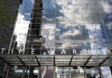 FILE - In this Oct. 24, 2016, file photo, clouds are reflected in the glass facade of the Time Warner building in New York. A federal appeals court on Tuesday, Feb. 26, 2019 upheld AT&T's $81 billion takeover of Time Warner, approving one of the biggest media deals on record in the face of opposition from the Trump administration. The combination of one of the country's largest wireless carriers and TV providers with a major TV and movie company has already reshaped the media landscape. (AP Photo/Mark Lennihan, File)