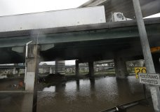 A truck drives over a flooded freeway underpass in San Francisco, Thursday, Feb. 14, 2019. The National Weather Service says the atmospheric river sagged southward from Northern California overnight and is pointed at the southwestern corner of the state early Thursday. (AP Photo/Jeff Chiu)