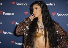 FILE - This Feb. 2, 2019 file photo, Cardi B arrives at the 2019 Fanatics Super Bowl Party in Atlanta. Even though Cardi B has a strong chance of winning her first-ever Grammy, the rapper says she is feeling nervous heading into the upcoming awards show. (Photo by Paul R. Giunta/Invision/AP, File)