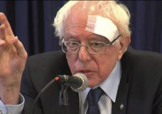 This image from video provided by WCIV-TV, shows Democratic presidential candidate Bernie Sanders speaks at at healthcare roundtable at the at the International Longshoremen's Association Hall on Friday, March 15 , 2019, in Charleston, S.C. Sanders was wearing a large gauze bandage on his forehead after cutting his head on a glass shower door earlier in the morning. (WCIV via AP)