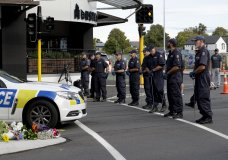Police officers prepare to search the area near the Masjid Al Noor mosque, site of one of the mass shootings at two mosques in Christchurch, New Zealand, Saturday, March 16, 2019. (AP Photo/Mark Baker)