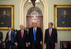 President Donald Trump accompanied by Senate Majority Leader Mitch McConnell of Ky., left, and Sen. Roy Blunt, R-Mo., right, arrives for a Senate Republican policy lunch on Capitol Hill in Washington, Tuesday, March 26, 2019. (AP Photo/Andrew Harnik)