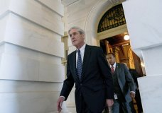 FILE - In this June 21, 2017 file photo, former FBI Director Robert Mueller, the special counsel probing Russian interference in the 2016 election, departs Capitol Hill following a closed door meeting in Washington. (AP Photo/Andrew Harnik, File)