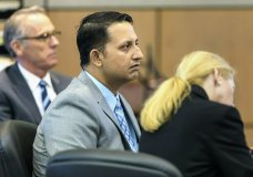 Nouman Raja sits between defense attorney Scott Richardson, left, and paralegal Debi Stratton as attorney Richard Lubin gives his closing arguments in Raja's trial, Wednesday, March 6, 2019 in West Palm Beach, Fla. Raja, a former Palm Beach Gardens police officer, is charged with the fatal 2015 shooting of stranded motorist Corey Jones. (Lannis Waters/Palm Beach Post via AP, Pool)