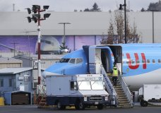 A worker walks up steps to the right of an avionics truck parked next to a Boeing 737 MAX 8 airplane being built for TUI Group at Boeing Co.'s Renton Assembly Plant Wednesday, March 13, 2019, in Renton, Wash. President Donald Trump says the U.S. is issuing an emergency order grounding all Boeing 737 Max 8 and Max 9 aircraft in the wake of a crash of an Ethiopian Airliner. (AP Photo/Ted S. Warren)