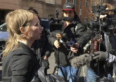 In this Tuesday, March 5, 2019 photo, Chelsea Manning addresses the media outside federal court in Alexandria, Va. The former Army intelligence analyst was ordered to jail Friday, March 8, 2019, for refusing to testify to a Virginia grand jury investigating Wikileaks. (AP Photo/Matthew Barakat)
