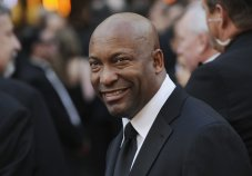 """FILE - In this Feb. 24, 2008 file photo, director John Singleton arrives at the 80th Academy Awards in Los Angeles. The family for Singleton says the filmmaker will be taken off life support Monday, April 29, 2019, after suffering a stroke almost two weeks ago. In a statement Monday, Singleton's family said it was """"an agonizing decision, one that our family made over a number of days with the careful counsel of John's doctors."""" (AP Photo/Chris Pizzello, File)"""