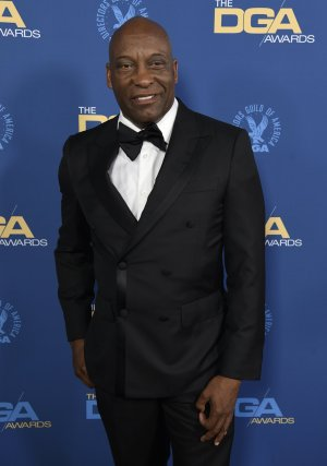 """FILE - This Feb. 2, 2019 file photo shows John Singleton at the 71st annual DGA Awards in Los Angeles. The family for Singleton says the filmmaker will be taken off life support Monday, April 29, 2019, after suffering a stroke almost two weeks ago. In a statement Monday, Singleton's family said it was """"an agonizing decision, one that our family made over a number of days with the careful counsel of John's doctors."""" (Photo by Chris Pizzello/Invision/AP, File)"""
