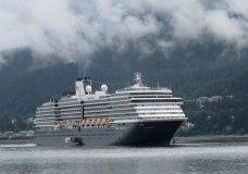 FILE- In this Aug. 29, 2011 file photo, the Holland America Westerdam, is shown in Juneau, Alaska. A federal judge in Miami threatened on Wednesday, April 10, 2019, to temporarily block Carnival Corp. from docking cruise ships at ports in the United States as punishment for a possible probation violation. (AP Photo/Becky Bohrer, File)