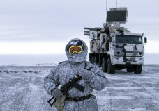 n this photo taken on Wednesday, April 3, 2019, a Russian solder stands guard as Pansyr-S1 air defense system on the Kotelny Island, part of the New Siberian Islands archipelago located between the Laptev Sea and the East Siberian Sea, Russia. Russia has made reaffirming its military presence in the Arctic the top priority amid an intensifying international rivalry over the region that is believed to hold up to one-quarter of the planet's undiscovered oil and gas. (AP Photo/Vladimir Isachenkov)
