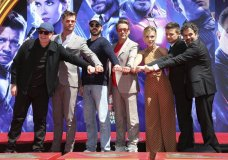 """Marvel Studios President Kevin Feige, from left, poses with members of the cast of """"Avengers: End Game,"""" Chris Hemsworth, Chris Evans, Robert Downey Jr., Scarlett Johansson, Jeremy Renner and Mark Ruffalo at a hand and footprint ceremony at the TCL Chinese Theatre on Tuesday, April 23, 2019, in Los Angeles. (Photo by Willy Sanjuan/Invision/AP)"""
