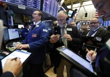 FILE- In this Feb. 12, 2019, file photo specialist Patrick King, left, works with traders at his post on the floor of the New York Stock Exchange. The U.S. stock market opens at 9:30 a.m. EDT on Wednesday, April 10. (AP Photo/Richard Drew, File)