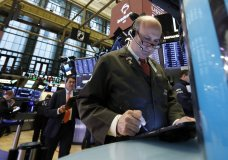 Trader Andrew Silverman, right, works on the floor of the New York Stock Exchange, Wednesday, May 1, 2019. Stocks are opening higher on Wall Street after several big U.S. companies reported earnings that were better than analysts were expecting. (AP Photo/Richard Drew)