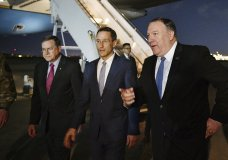 Secretary of State Mike Pompeo, right walks with Acting Assistant Secretary for Near Eastern Affairs at the State Department David Satterfield, left, and Charge D'affaires at the U.S. Embassy in Baghdad Joey Hood upon arrival in Baghdad, on Tuesday, May 7, 2019. (Mandel Ngan/Pool Photo via AP)