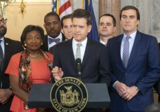 New York State Senator Brad Hoylman, D-Manhattan, center, speaks during a news conference, Wednesday, May 8, 2019, at the Capitol in Albany, N.Y., about a senate bill to authorize the release of individual New York state tax returns to Congress. Listening at left is Senate Majority Leader Andrea Stewart-Cousins, D-Yonkers, state Sen. Michael Gianaris, D-Queens, right. The bill now goes to the Democrat-led state Assembly after the Democrat-controlled Senate easily passed it. (AP Photo/Tim Roske)