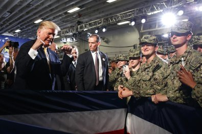 President Donald Trump greets troops after speaking at a Memorial Day event aboard the USS Wasp, Tuesday, May 28, 2019, in Yokosuka, Japan. (AP Photo/Evan Vucci)