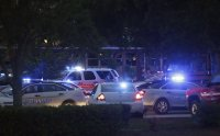 Emergency vehicles fill the parking lot at the Princess Anne Middle School in Virginia Beach, Va, on Friday, May 31, 2019. A longtime city employee opened fire at a municipal building in Virginia Beach on Friday, killing 11 people before police shot and killed him, authorities said. Six other people were wounded in the shooting, including a police officer whose bulletproof vest saved his life, said Virginia Beach Police Chief James Cervera. (AP Photo/Vicki Cronis-Nohe)