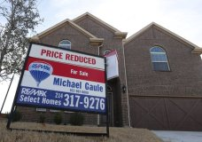 FILE - In this Wednesday, Feb. 20, 2019, photo a price reduced for sale sign sit in front of a home in north Dallas. On Thursday, May 30, Freddie Mac reports on this week's average U.S. mortgage rates. (AP Photo/LM Otero, File)
