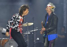 FILE - In this May 25, 2018 file photo, Mick Jagger, left, and Keith Richards, of The Rolling Stones, perform during their No Filter tour in London. The 75-year-old rocker on Wednesday, May 15, 2019 tweeted a video of him dancing around a studio in front of a mirror weeks after he underwent medical treatment, reportedly for a heart valve issue. The treatment forced the postponement of the Rolling Stones' No Filter tour.(Photo by Mark Allan/Invision/AP, File)
