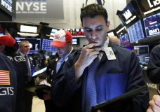FILE - In this May 9, 2019, file photo trader Craig Spector works on the floor of the New York Stock Exchange. The U.S. stock market opens at 9:30 a.m. EDT on Friday, May 17. (AP Photo/Richard Drew)