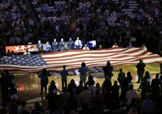 FILE - In this Wednesday, Oct. 26, 2016 file photo, first responders hold a flag on the court as the national anthem is played during a tribute to the victims of the Pulse nightclub shooting prior to an NBA basketball game between the Orlando Magic and the Miami Heat in Orlando, Fla. The attack left 49 people dead; the shooter was killed after a three-hour standoff with police. (AP Photo/John Raoux)