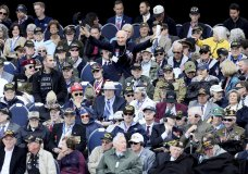 U.S. World War II veteran Jacques Michienzi, center, stands up among other veterans during a ceremony to mark the 75th anniversary of D-Day at the Normandy American Cemetery in Colleville-sur-Mer, Normandy, France, Thursday, June 6, 2019. World leaders are gathered Thursday in France to mark the 75th anniversary of the D-Day landings. (AP Photo/David Vincent)