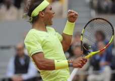 Spain's Rafael Nadal clenches his fist after scoring a point against Switzerland's Roger Federer during their semifinal match of the French Open tennis tournament at the Roland Garros stadium in Paris, Friday, June 7, 2019. (AP Photo/Michel Euler)