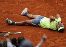 Spain's Rafael Nadal celebrates his record 12th French Open tennis tournament title after winning his men's final match against Austria's Dominic Thiem in four sets, 6-3, 5-7, 6-1, 6-1, at the Roland Garros stadium in Paris, Sunday, June 9, 2019. (AP Photo/Jean-Francois Badias)