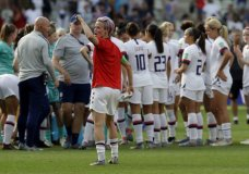 United States'Megan Rapinoe, front, celebrates at the end of the Women's World Cup round of 16 soccer match between Spain and US at the Stade Auguste-Delaune in Reims, France, Monday, June 24, 2019. US beat Spain 2-1. (AP Photo/Alessandra Tarantino)