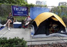 Anna Connelly, left, and Jeanna Gullett supporters of President Donald Trump, make camp Monday, June 17, 2019, in Orlando, Fla. as they wait to attend a rally for the president on Tuesday evening. (AP Photo/John Raoux)
