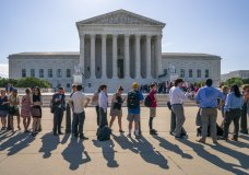 Visitors line up to enter the Supreme Court on Capitol Hill in Washington, Monday, June 24, 2019. (AP Photo/J. Scott Applewhite)