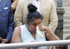 Esaw Snipes, widow of chokehold victim Eric Garner, wipes her eyes during a news conference outside the U.S. Attorney's office, in the Brooklyn borough of New York, Tuesday, July 16, 2019. Federal prosecutors won't bring civil rights charges against New York City police officer Daniel Pantaleo, in the 2014 chokehold death of Garner, a decision made by Attorney General William Barr and announced one day before the five-year anniversary of his death, officials said. (AP Photo/Richard Drew)