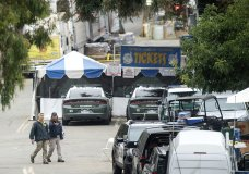 FBI personnel pass a ticket booth at the Gilroy Garlic Festival Monday, July 29, 2019 in Calif., the morning after a gunman killed at least three people, including a 6-year-old boy, and wounding about 15 others. A law enforcement official identified the gunman, who was shot and killed by police, as Santino William Legan. (AP Photo/Noah Berger)