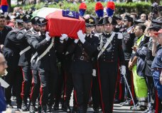 The coffin containing the body of Carabinieri's officer Mario Cerciello Rega is carried to his funeral in his hometown of Somma Vesuviana, near Naples, southern Italy, Monday, July 29, 2019. Two American teenagers were jailed in Rome on Saturday as authorities investigate their alleged roles in the fatal stabbing of the Italian police officer on a street near their hotel. (AP Photo/Andrew Medichini)