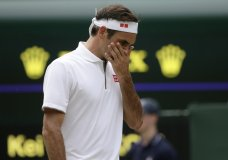 Switzerland's Roger Federer is dejected after losing a point to Japan's Kei Nishikori during a men's quarterfinal match on day nine of the Wimbledon Tennis Championships in London, Wednesday, July 10, 2019. (AP Photo/Tim Ireland)