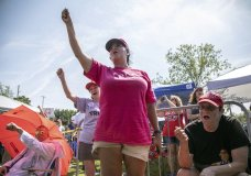 """From left, Maureen Fuster, Rosealinda Dorris and Carole Greenberg chant """"Trump"""" while waiting in line to see President Donald Trump, Wednesday morning, July 17, 2019 prior to a campaign rally at East Carolina University in Greenville, NC.(Travis Long/The News & Observer via AP)"""
