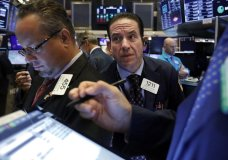 Trader Tommy Kalikas, center, works on the floor of the New York Stock Exchange, Wednesday, July 31, 2019. Stocks are opening slightly higher on Wall Street led by gains in Apple and other technology companies. (AP Photo/Richard Drew)