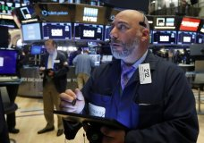 FILE - In this July 1, 2019, file photo trader Vincent Napolitano works on the floor of the New York Stock Exchange. The U.S. stock market opens at 9:30 a.m. EDT on Wednesday, July 3. (AP Photo/Richard Drew, File)