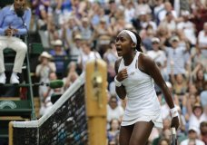 "United States' Cori ""Coco"" Gauff reacts after winning the second set against Slovenia's Polona Hercog in a Women's singles match during day five of the Wimbledon Tennis Championships in London, Friday, July 5, 2019. (AP Photo/Ben Curtis)"