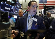 FILE - In this Aug. 6, 2019, file photo trader Tommy Kalikas works on the floor of the New York Stock Exchange. The U.S. stock market opens at 9:30 a.m. EDT on Friday, Aug. 9. (AP Photo/Richard Drew, File)