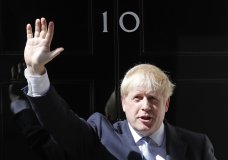 FILE - In this file photo dated Wednesday, July 24, 2019, Britain's Prime Minister Boris Johnson waves from the steps outside 10 Downing Street in London. In a letter released Wednesday Aug. 28, 2019, Prime Minister Johnson has written to fellow lawmakers explaining his decision to ask Queen Elizabeth II to suspend Parliament as part of the government plans before the Brexit split from Europe. (AP Photo/Frank Augstein, FILE)