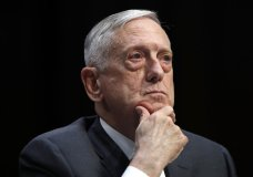 """FILE - In this April 26, 2018, file photo, Defense Secretary Jim Mattis listens to a question during a hearing on Capitol Hill in Washington. Mattis warns bitter political divisions have pushed American society to the """"breaking point"""" in his most extensive public remarks since he resigned in protest from the Trump administration. (AP Photo/Jacquelyn Martin, File)"""