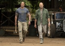 "This image released by Universal Pictures shows Dwayne Johnson, left, and Jason Statham in a scene from ""Fast & Furious Presents: Hobbs & Shaw."" Movie going audiences have helped the ""Fast & Furious"" spinoff ""Hobbs & Shaw"" take another lap at No. 1 even with the onslaught of new movies this weekend. Universal Pictures estimates Sunday, Aug. 11, 2019 that ""Hobbs & Shaw"" added $25.4 million from North American theaters, bringing its domestic total to $108.5 million. (Frank Masi/Universal Pictures via AP)"