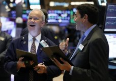 FILE - In this July 22, 2019, file photo traders James Riley, left, and Mark Muller work on the floor of the New York Stock Exchange. The U.S. stock market opens at 9:30 a.m. EDT on Thursday, Aug. 1. (AP Photo/Richard Drew, File)